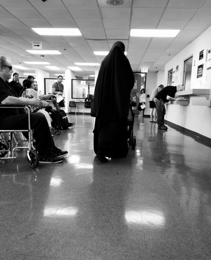 Black and white photo of Muslim woman Public aid office Rolling Meadows