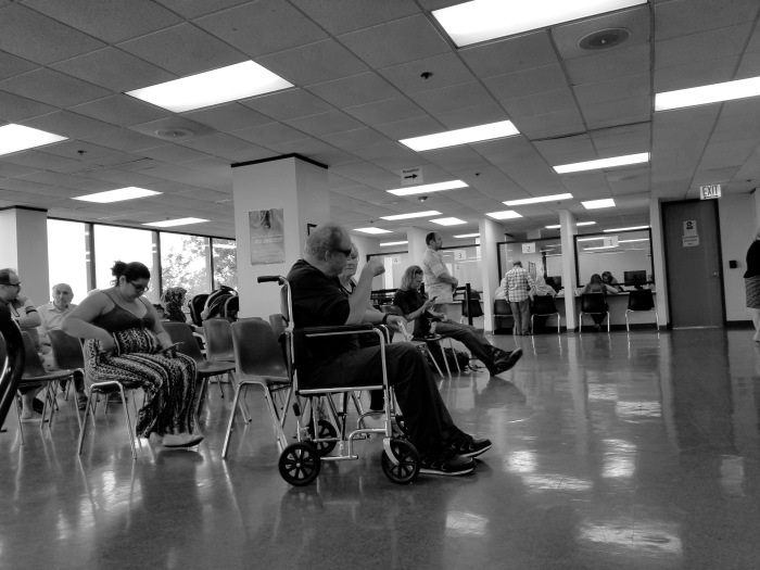 Man in wheelchair waiting room Public aid office Rolling Meadows