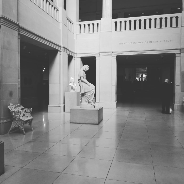 Black and white photo of maiden statue at The Art Institute of Chicago